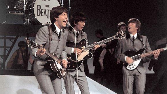 a life history of john lennon of the beatles music band